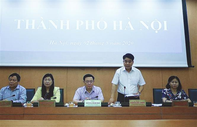 Trong ảnh: Chủ tịch UBND thành phố Hà Nội Nguyễn Đức Chung phát biểu tại điểm cầu Hà Nội. Ảnh: Thống Nhất – TTXVN